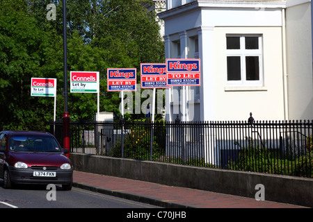 Row of To Let and Let By signs in street, Tunbridge Wells , Kent , England - Stock Photo