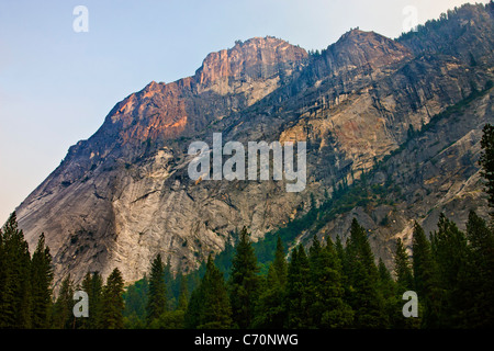 Granite cliffs in Yosemite National Park, USA, touched by evening sunlight. JMH5252 - Stock Photo