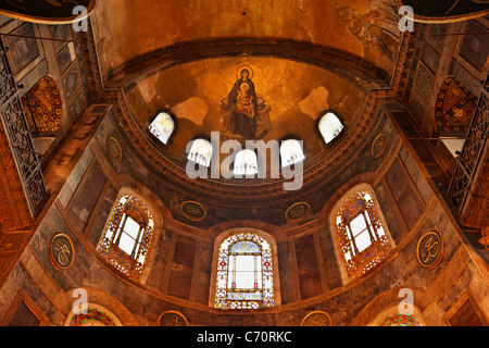 A beautiful fresco (mosaic) of Virgin Mary holding in her hands baby Jesus. Photo taken in Hagia Sofia, Istanbul. - Stock Photo