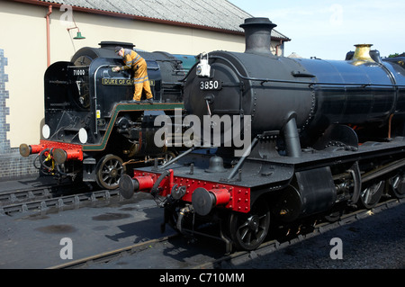 Unique BR Standard pacific 'Duke of Gloucester' No 71000 alongside Great Western 38XX 2-8-0 No 3850, Minehead Station, - Stock Photo