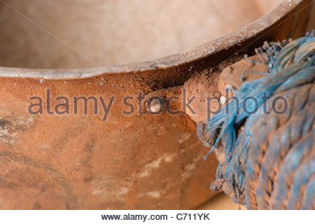 Pasta saucepan covered with African dust and dirt - Stock Photo