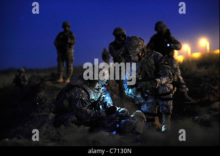 U.S. Army 2nd Lt. Chang Ahn, leader of 2nd Platoon, 5th Battalion, 82nd Field Artillery Regiment, and Maj. David - Stock Photo