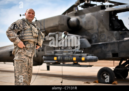 Having accrued 5,200 hours of flight time in his Army career, Chief Warrant Officer 5 Donald Washabaugh, from Collingswood, N.J., the brigade aviation maintenance officer and an AH-64D Apache attack helicopter pilot in 1st Air Cavalry Brigade, 1st Cavalry Division, U.S. Division-Center, dons his flight gear before making his final flight in an Army helicopter March 25. Washabaugh will be leaving to support aviation supply at the Department of the Army. Stock Photo