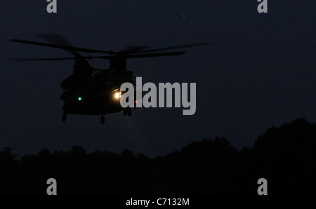 A U.S. Army CH-47 Chinook helicopter readies for Soldiers assigned to the 4th Battalion, 10th Special Forces Group - Stock Photo