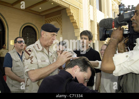 Army Gen. Tommy Franks, commander of U.S. Central Command, speaks with reporters outside a hotel in Abu Dhabi, United - Stock Photo