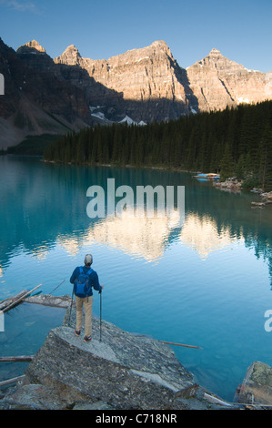 Male hiker on rock at Moraine Lake, Lake Louise, Banff National Park, Albreta, Canada. - Stock Photo