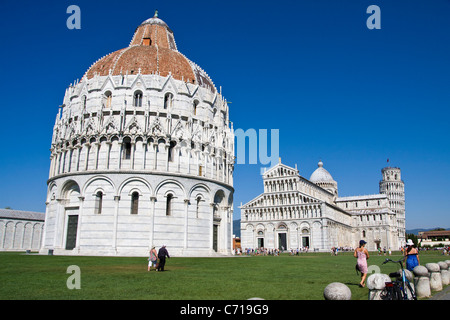The baptistry , cathedral and leaning tower ( campanile) in the field of miracles in Pisa Italy - Stock Photo