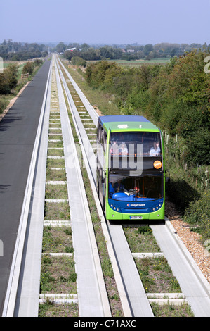 A guided bus on the guided busway between Cambridge and St. Ives, Cambridgeshire. - Stock Photo