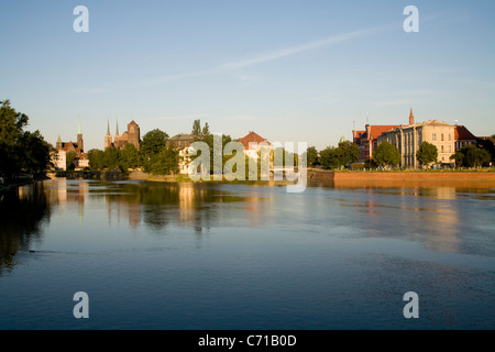 View from Uniwersytecki Bridge across The Odra River on the Ostrow Tumski  Old Town in Wroclaw Poland - Stock Photo