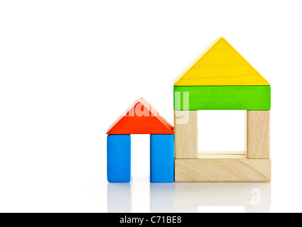 Houses built out of toy wooden building blocks - Stock Photo