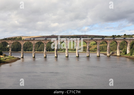 An East Coast High Speed Train crosses the Royal Border Bridge over the river Tweed in Berwick, Northumberland, - Stock Photo