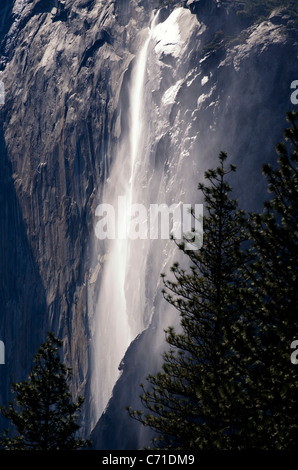 Located on the east side of El Capitan, Horsetail Fall is a seasonal waterfall that flows in the winter and early - Stock Photo