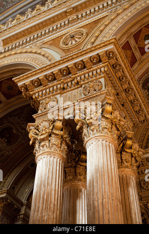 Golden Classic Columns of the Ceremonial Hall at Dolmabahce. Quad columns support the massive dome of the grand - Stock Photo