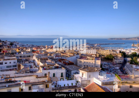 A rooftop view of the city of Tangier looking out onto the Mediterranean Sea, Morocco. - Stock Photo