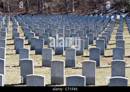 Rough Triangles of Canadian Military headstones. In Bayview Cemetery's military section grey granite headstones - Stock Photo