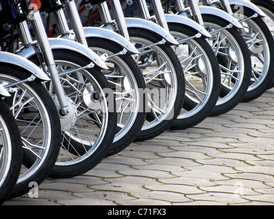 row of motorcycle wheels - Stock Photo