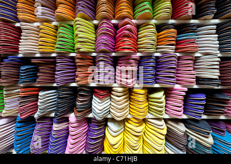 Soft leather Moroccan slippers in the Souk, Medina, Marrakesh, Morocco, North Africa - Stock Photo