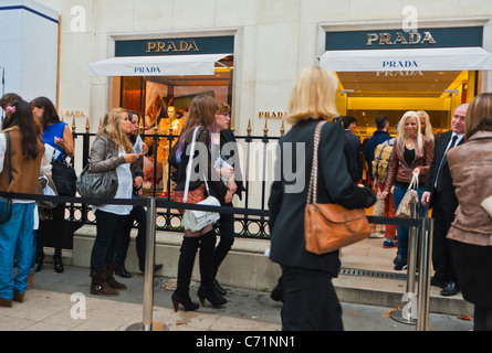 Paris, France, Teenagers Queuing Outside Italian Luxury Clothing Store, Prada, Fashion Ni-ght, Sale Shopping Street,'Avenue - Stock Photo
