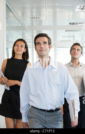 Executives walking in office - Stock Photo