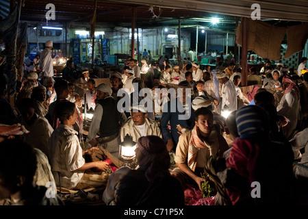 The night khat market in Zabid, Yemen. - Stock Photo