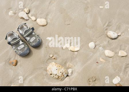 Child's sandals on beach - Stock Photo
