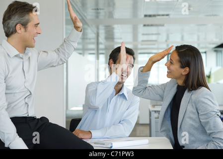 Colleagues giving high-five - Stock Photo