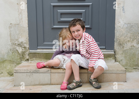 Young brother and sister embracing, portrait - Stock Photo