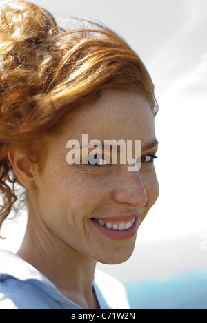 Redheaded woman, portrait - Stock Photo