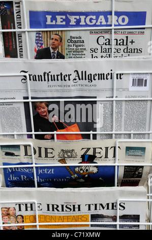 International Newspapers on sale, Cambridge, England, UK - Stock Photo