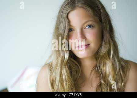 Young woman looking at camera, portrait - Stock Photo