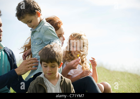 Family spending time together outdoors - Stock Photo