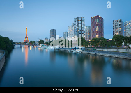 France, Paris, Night View Of River Seine With High-rise Buildings On The Left Bank And Eiffel Tower - Stock Photo