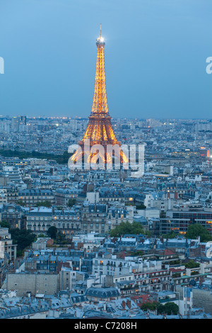 France, Paris, Eiffel Tower, viewed over rooftops - Stock Photo
