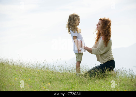 Mother comforting young daughter outdoors - Stock Photo