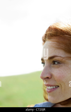 Woman outdoors, looking away, portrait - Stock Photo