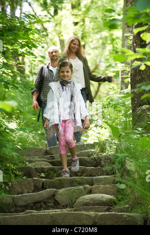 Family walking down steps in woods - Stock Photo