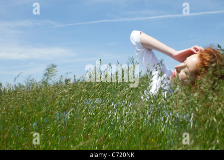 Woman lying in grass - Stock Photo