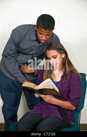 Multi ethnic African American boy and Hispanic girl read the Bible together.14-18- year old olds MR © Myrleen Pearson - Stock Photo