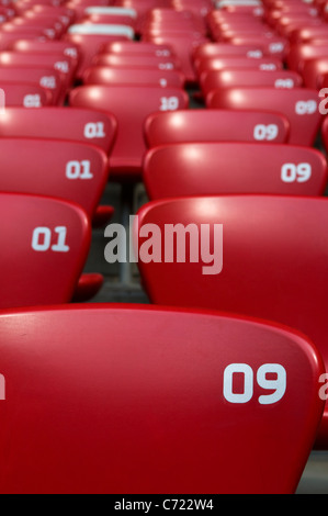 Red chairs at a stadium - Stock Photo
