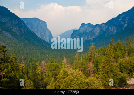 Yosemite Valley, National Park, El Capitan left, Bridalveil Falls right, from Tunnel View, with forest fire smoke - Stock Photo
