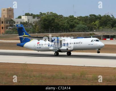 Tuninter ATR 72 short haul turboprop airliner taking off from Malta - Stock Photo