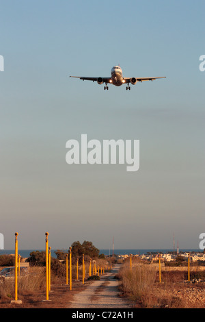Front view of Airbus A319 passenger jet plane on flight path for landing - Stock Photo