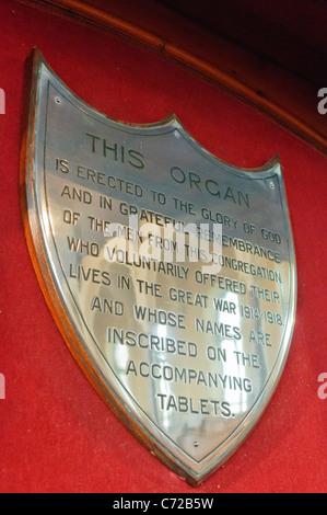 Brass plaque on a Church organ commemorating it to the soliders killed during Word War 1 - Stock Photo