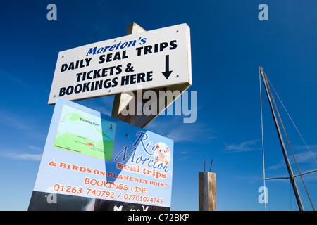 Adverts for seal watching trips from Blakeney Harbour, North Norfolk coast, UK. - Stock Photo