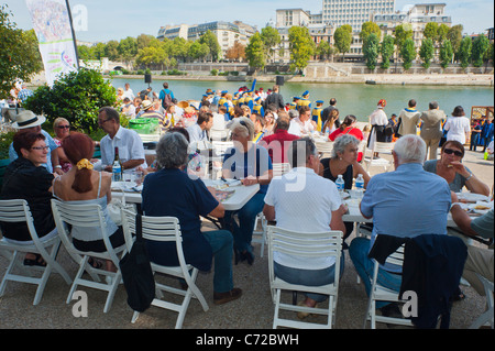 Paris, France, French Food and Wine Festival, St. Pourcinois, French Families Picnicking on Seine Quay - Stock Photo
