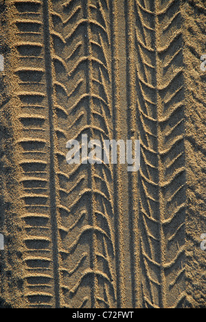 tyre tracks in beach sand, West Point, Magnetic Island, off Townsville, Queensland, Australia - Stock Photo