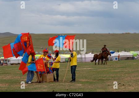flag vendors, Horse racing competition, Naadam Festival,  Khui Doloon Khudag  (outside) Ulaanbaatar, Mongolia. © - Stock Photo