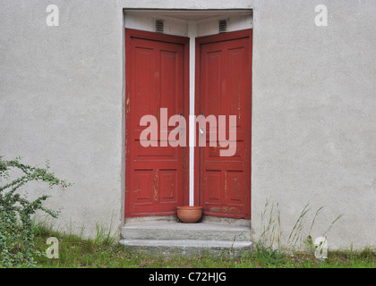 Two red doors equal - Stock Photo