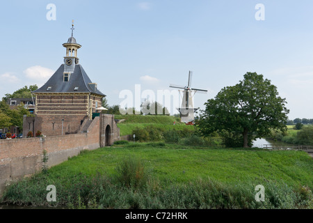 The Dalempoort (Dalemgate) and the windmill de Hoop (The Hope), Gorinchem, Holland - Stock Photo
