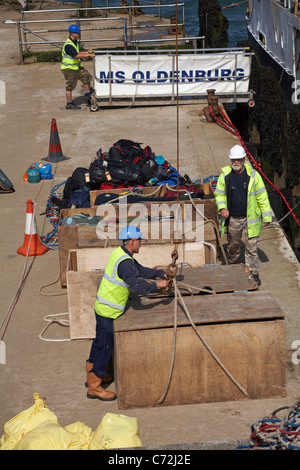 Preparing to lift luggage on M.S. Oldenburg for staying visitors to Lundy Island on quayside at Ilfracombe, Devon, - Stock Photo